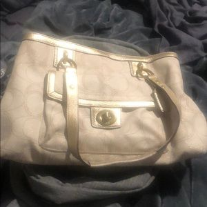 Gold and cream coach bag